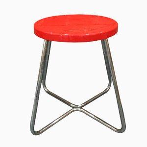 Taburete funcionalista de acero con asiento en rojo, años 30