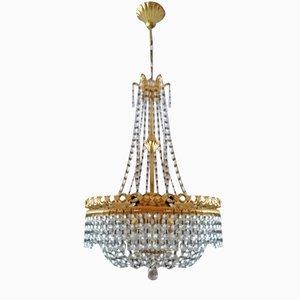 Lámpara de araña vintage con elementos de bronce