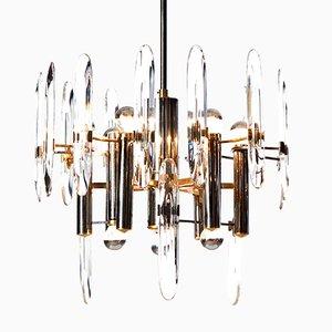 Lámpara de araña Mid-Century de cromo, latón y cristal con nueve luces de Gaetano Sciolari