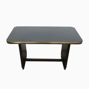Mesa vintage de madera con superficie de vidrio negro incrustado, años 50