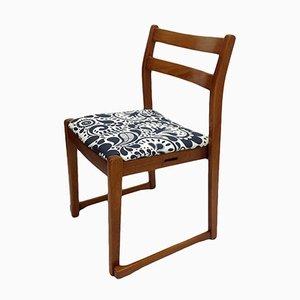 Silla auxiliar vintage de teca con asiento estampado
