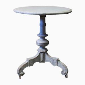 Tavolino rotondo in stile gustaviano dipinto di grigio e con rotelle, metà XIX secolo