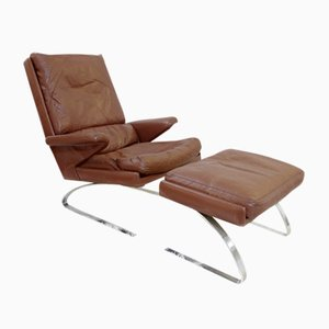 Swing Lounge Chair and Ottoman by R. Adolf & H. J. Schropfer
