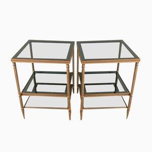 Mesas auxiliares de acero niquelado en dorado con tres bandejas de vidrio. Juego de 2