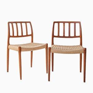 Sillas vintage de teca maciza con asientos de cuerda de N. O. Møller para JL Miller's Furniture. Juego de 4