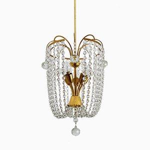 Lámpara de araña Mid-Century de latón y cristal, años 50