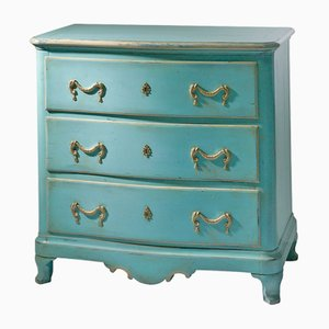 Cajonera vintage azul con detalles de latón