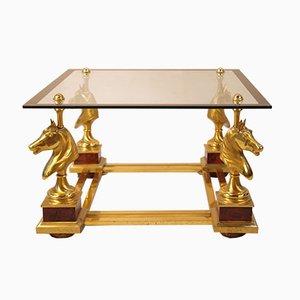 Mesa de centro vintage de metal dorado y vidrio con 4 bustos de caballos, años 70