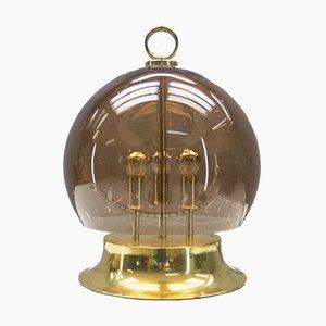 Lámpara dorada con globo de vidrio soplado ahumado