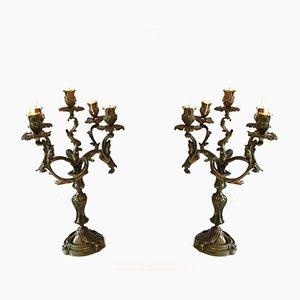 Candeleros de bronce con cinco brazos, década de 1900. Juego de 2