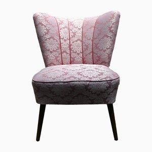 Silla de cóctel vintage rosa con patas de madera