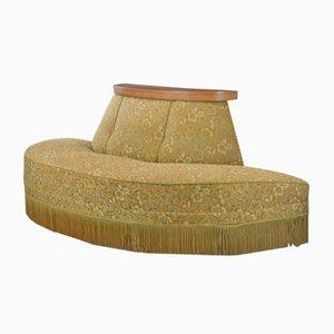 Sofá antiguo con fleco