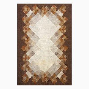 Alfombra Rölakan sueca de tejido plano marrón de Brita Svensson
