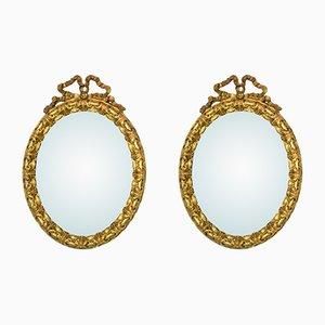 Espejos antiguos dorados con forma de cinta. Juego de 2