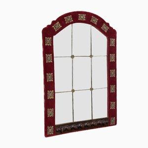 Espejo de pared antiguo de cristal tallado y terciopelo