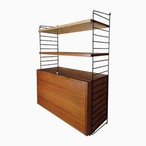Estante de pared con mueble para discos y dos estantes de Nisse Strinning para String, años 50