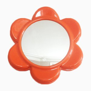 Espejo naranja con forma de flor, años 70
