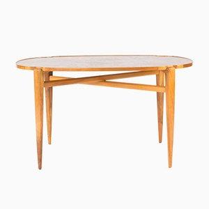 Mesa de centro de madera de nogal de Axel Larsson para Hjalmar Jackson, años 40