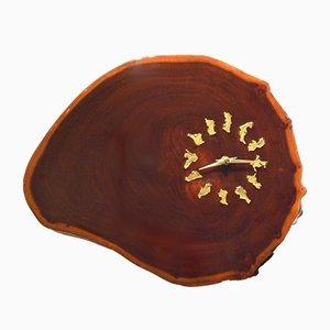 Reloj de pared en forma de sección de tronco de caoba esmaltada, años 70
