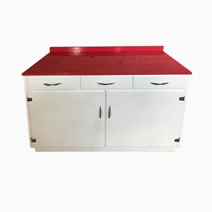 Mueble de cocina con superficie de melamina roja, años 50