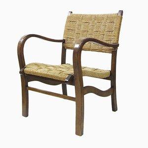 Butaca de roble con respaldo y asiento de mimbre, años 30