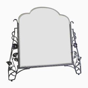 Espejo Art Decó con cristal facetado en el marco de acero
