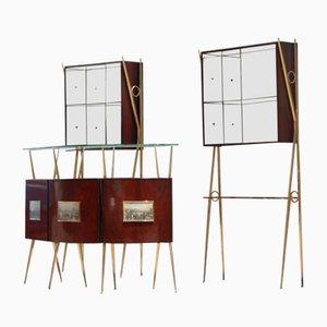 Dos vitrinas italianas y un mueble bar, años 50
