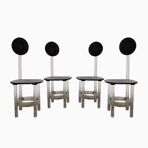Sillas de comedor esculturales de metacrilato negro y transparente con respaldo alto, años 70. Juego de 4