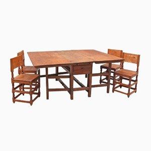 Juego de comedor con mesa y cuatro sillas, siglo XVIII
