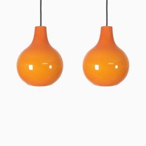 Lámparas colgantes de vidrio naranja de Peill & Putzler, años 70. Juego de 2
