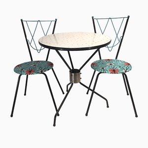 Juego de comedor vintage con una mesa y dos sillas