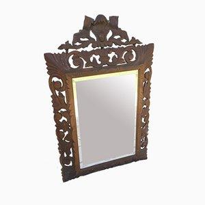 Specchio con cornice in legno intagliato, XVIII secolo