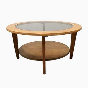 Mesa de centro danesa vintage redonda con vidrio, años 60