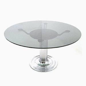 Mesa de comedor redonda de vidrio y metal cromado, años 70