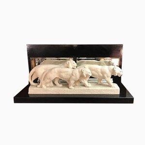Lámpara vintage con escultura de leonas