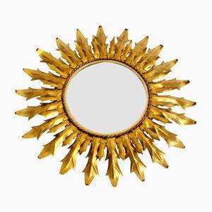 Specchio a forma di sole in ferro dorato, anni '60