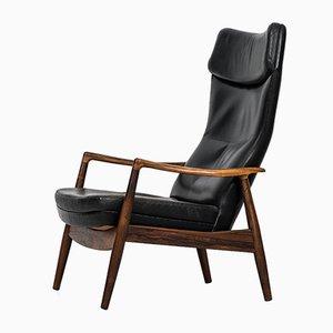 Silla reclinable de palisandro de Ib Kofod-Larsen para Povl Dinesen, años 50