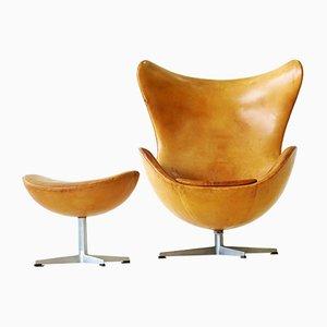Egg chair con ottomana in pelle di Arne Jacobsen per Fritz Hansen, anni '60