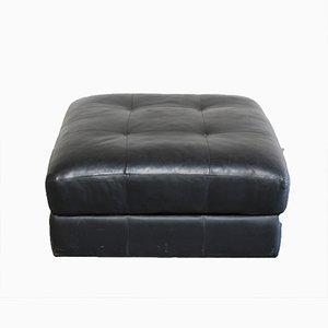 Pouf DS88 vintage in pelle nera di De Sede