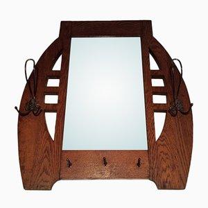Espejo antiguo de roble y latón