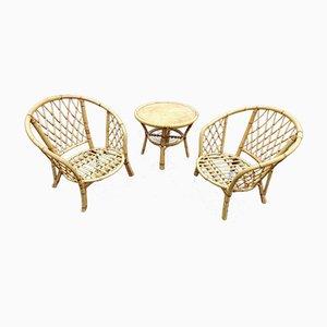 Juego francés de silla y mesa de ratán, años 70. Juego de 3