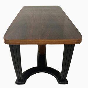 Mesa de comedor de caoba y madera ebonizada con superficie de vidrio opalino negro, años 40