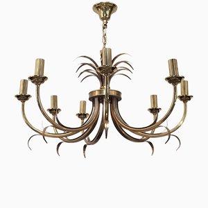Lámpara de araña de acero cepillado y latón con ocho brazos de Maison Charles, años 70