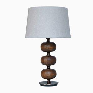 Lámpara de mesa de caoba y latón con tres esferas de Henrik Blomqvist para Tranas Stilarmatur, años 50