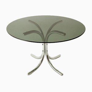 Mesa de comedor italiana cromada con superficie redonda de vidrio, años 70