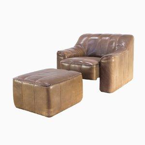Butaca DS44 con asiento ajustable y otomana de de Sede, años 70