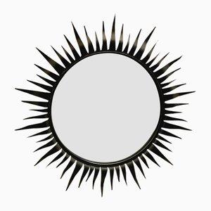 Espejo circular en forma solar con marco de hierro forjado de Chaty Vallauris, años 50