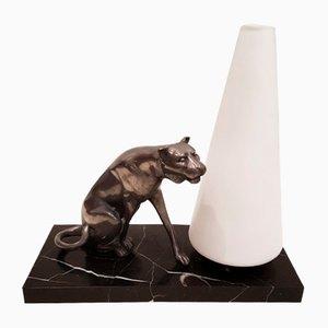 Lampada da tavolo con scultura rappresentante un gatto selvatico, anni '40