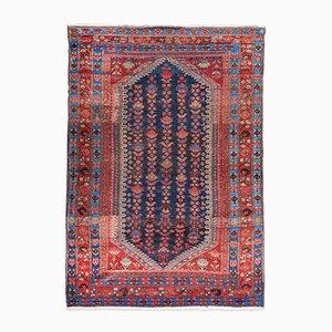Antiker Teppich mit Blumenmuster