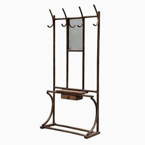 Perchero Mid-Century de madera con cuatro ganchos, un espejo y un cajón